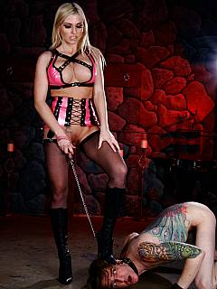 Dominant blonde is walking her petboy on a leash smiling to the camera