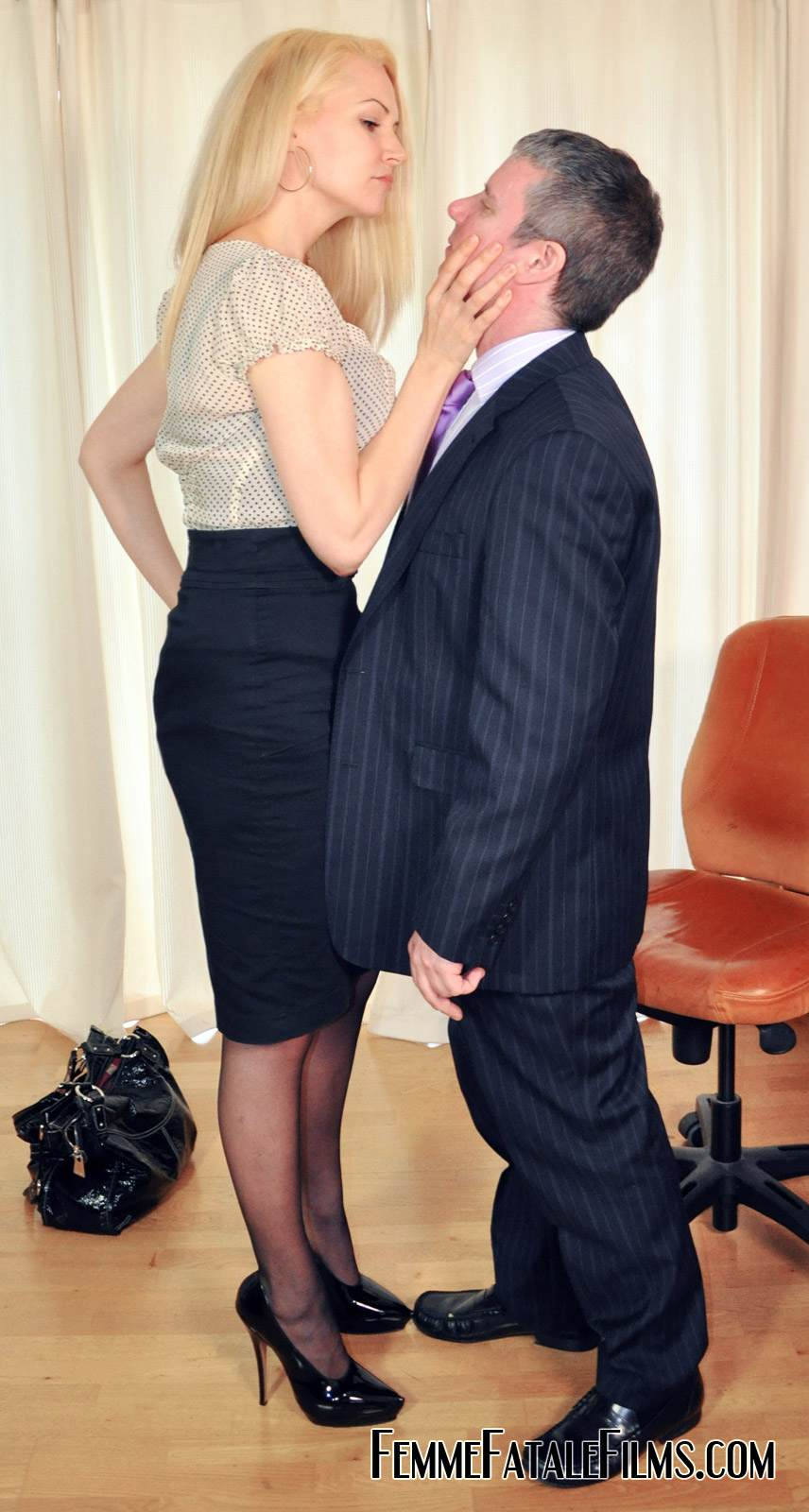 Picture #2 of Job interview ends up well for dominant secretary who spanks her future boss over the knee
