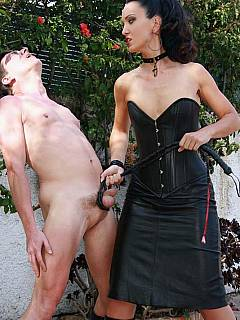 Dominatrix dragged her slave on a rope leash to the backyard where he sprayed his cum all over her ass