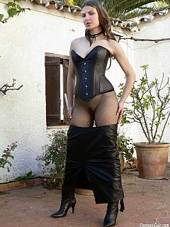 Amateur dominatrix is showing off the leather outfit she is going to punish you in