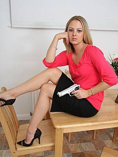 Babe looks pretty innocent except the gun she in holding in her hands