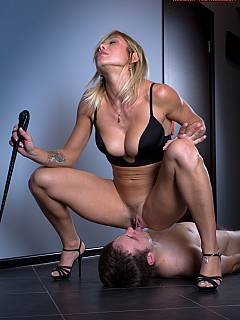 Bikini babe is walking male on a leash and making stop to pee on her slave and have her pussy licked