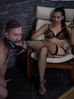 Femdom slave becomes submissive and worship girl's feet after his balls getting beaten up