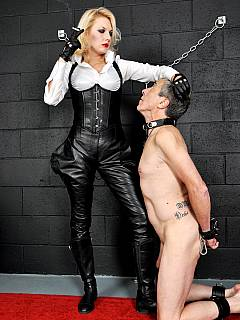 Whipping mistress is enjoying a cigarette and blowing smoke into slave's mouth