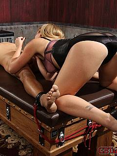 Cruel blonde is pushing steel needle into slave's penis not paying attention to the loud screams he is making