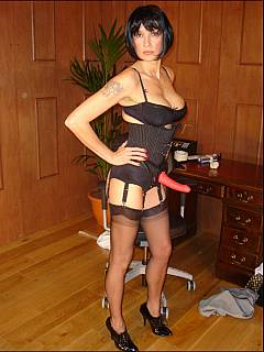 Strict dominatrix is keeping office sissy motivated by banging his ass with big red strap-on