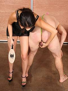 Naughty girl is paddling male hard while holding his balls in her hand