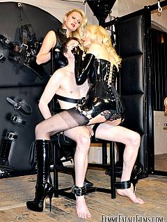 Hot blonde mates are spitting male slave in his mouth and leaving him to air to breath by putting gas mask over his head