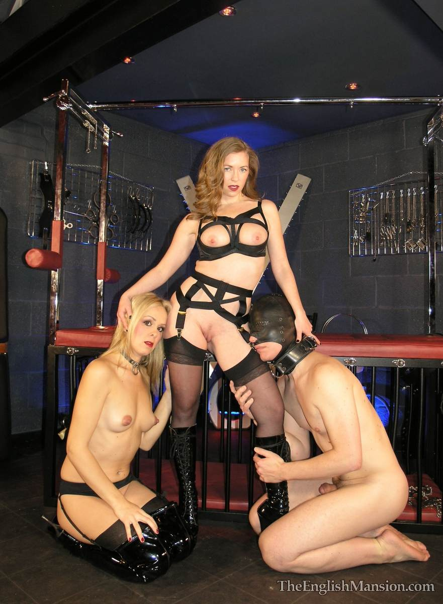 Picture #9 of Dominatrix is controlling a couple: male was caged but then allowed to get out and fuck the girl