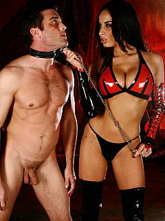 Goddess in latex bikini is using a leash to put her slave in close contact with her sexy ass