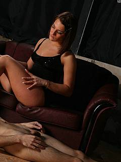 Dominant bitch gags foot-loving male slave with her high heel shoes and kicks his balls afterwards