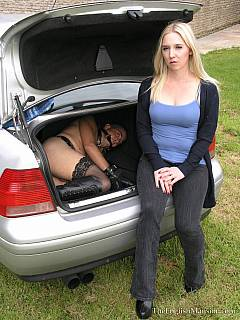 Dominatrix is transporting feminized slave in the back of her car: planning to cuff him to tree and work out her boxing skills