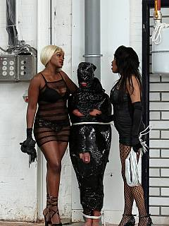 Black bitches painted slave's lips red, wrapped him in plastic, tied to post and then whipped
