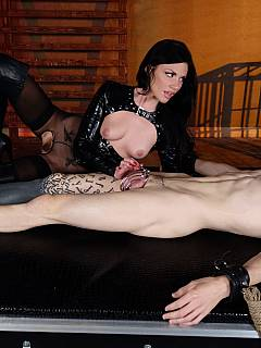 Crule lady is teasing male in bondage: licking his cock while it is locked in chastity cage