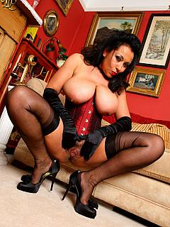 Fetish mistress is up for dominating job once dressed up in tight red corset