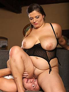 Fat mistress is can't wait to feel male face moving in between her legs while she is stroking his cock