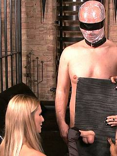 Three naughty ladies are in the prison cell: facesitting male sub while he is helplessly wrapped in plastic