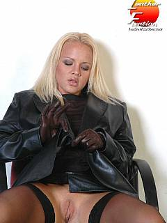 Blond babe in leather is doing kinky moves with her hands in gloves making sure her pussy is visible under the skirt
