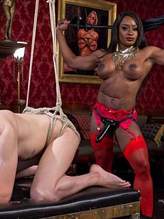 White sissy becomes a maid for big black body-builder woman that is punishing and fucking him on a daily basis