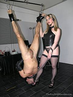 Bondage suspension gives naughty dominatrix ability to humiliate her slave sexually in any way she wants to