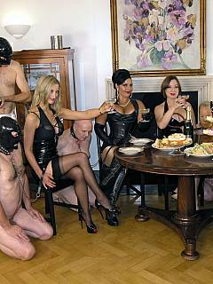 A group of beautiful femdom girls are having a party each bringing her own slave to serve