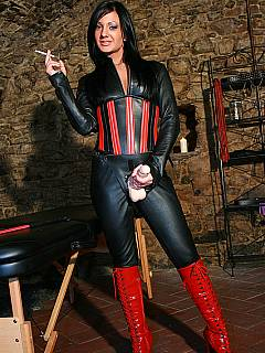 Leather domme finishes her cigarette before starting the strap-on femdom action