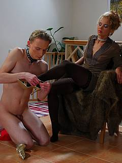 Femdom slave is serving his mistress as maid and spreading his ass silently each time she wants to bang him with jelly dildo