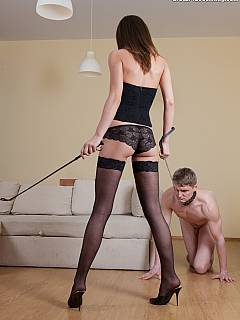 Girl is pleasuring femdom slave by crushing his head in between her legs in black nylons