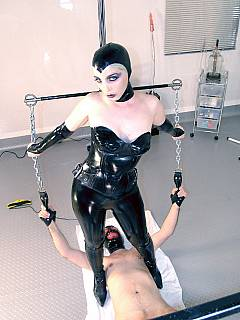 Mistress is put herself in a rubber catsuit, wearing mask and setting up a series of medical femdom experiments