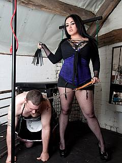 Cross-dressed sissy is trampled by busty dominatrix and then violated with whipping and kicks in his balls
