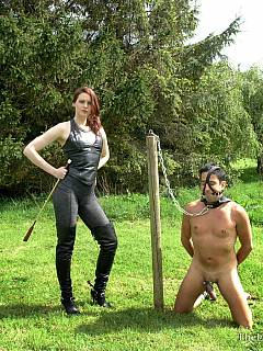 Ponyboy is carrying dominatrix on his shoulders while she is controlling his moves with the horse crop