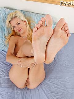 Blond mistress is using her pussy and sensual feet to tease a man and ruin his orgasms for a very long time