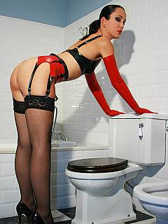 Goddess in PVC lingerie and black stockings is on top of the toilet: pissing and waiting for you to lick her cunt clean afterwards