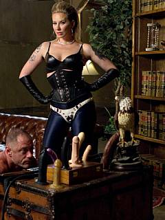 Worthless slave is presented a set of rubber dicks dominatrix is going to fuck him with during the femdom session