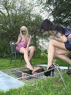 Hot blond and brunette is keeping collared slave in a ditch not letting him go above the level of their feet