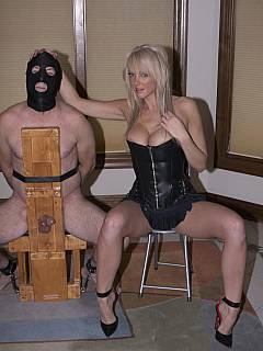 Blond tied her slave to BDSM rack so she could crush his cock and balls with her shoes and ruin his every orgasm
