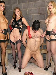 Three gorgeous domme ladies are in the BDSM cell: all nude, wearing sexy stockings and making two femdom slaves suck each other dicks