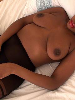 Black femdom Goggess is in bed: taing dwon her bra and ripping pantyhose expecting you to lick her pussy
