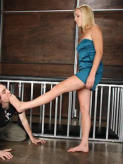 Kneeling sub is having last chance to taste mistress bare feet before going into pet cage