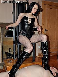 Mistress is making fat slave happy by using custom-made high heel boots for trampling his junk