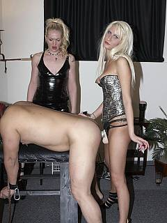 Girlfriends are not going to let this slave be bored: there are high heel shoes for him to lick and big strap-on cocks to take into his worthless ass