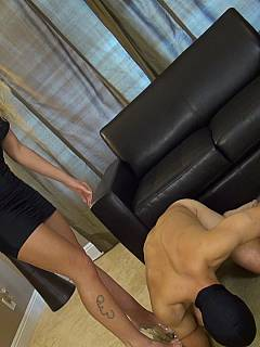 Blond Goddess is squeezing balls in her fist until they getting red and swollen