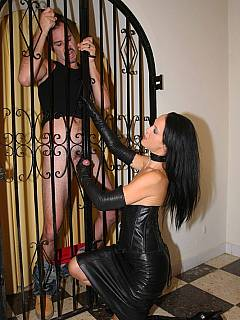 Topless mistress in black leather is teasing cock in gloves. collects all the cum and makes the slave swallow it all