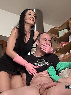Chair-tied male is not going anywhere until a couple of domme sluts in rubber gloves are getting the last drops of cum out of his cock