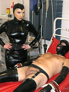 Rubber-dressed Goddess strapped male to the medical bed and doing painful things to his ass, penis and nipples
