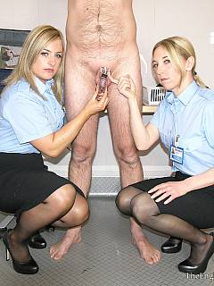 A couple of girls in security service uniform are searching the male finding out that his cock is locked into chastity device