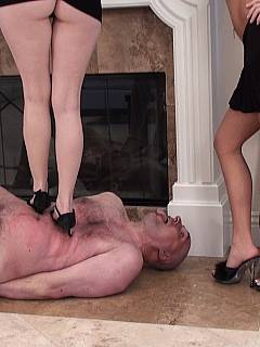 Leggy sluts are taking turns in trampling tied up male slave with high heels, leaving painful marks on his chest