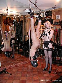 Good old anal strap-on is the best way to educate a man: blond domme is doing it doggy style and in upsidedown suspension