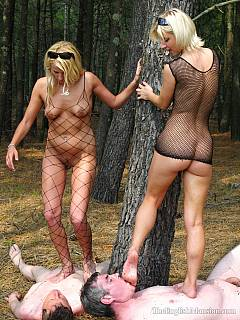 A couple of hot blond girls in fishnets are on the outdoor mission: trampling worthless nude men in the forest