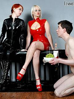 Willing slave served food for two ladies and then get down to become a garbage can for the dommes